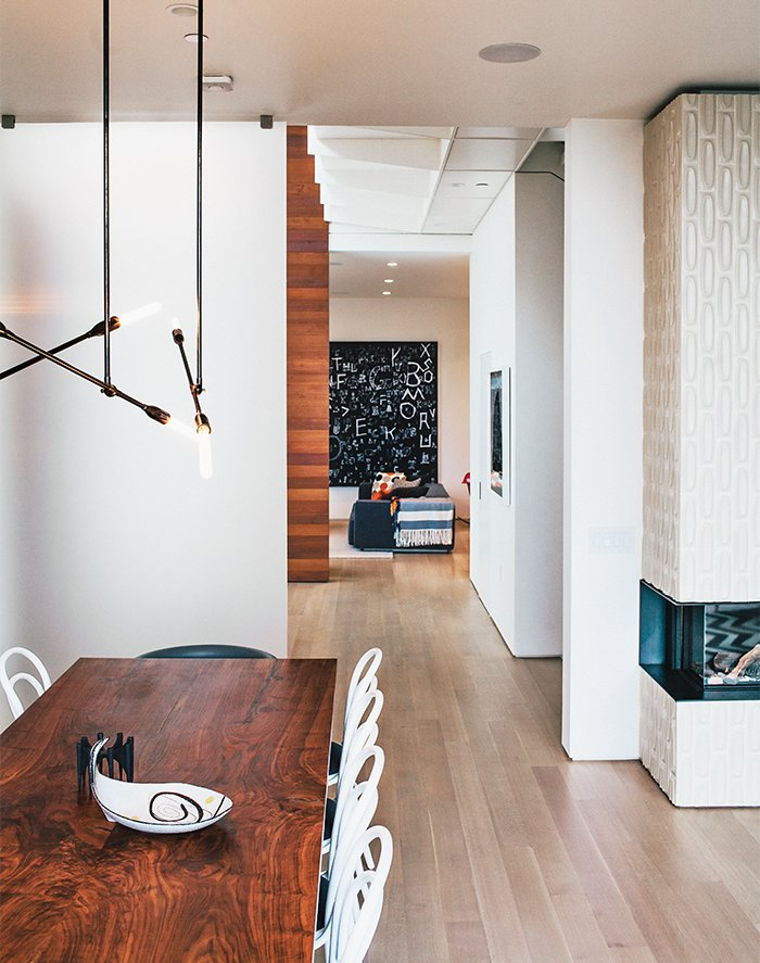 The catwalk above leads to the master bedroom. The living-dining room's Stix chandelier is from Nido Living.  Photo 6 of 19 in A Home with Eclectic Style Looks Just Right