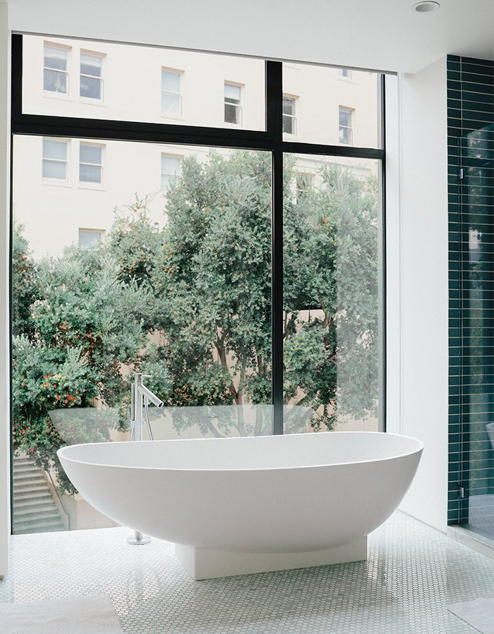 The bathroom features a tub by Benedini Associati for Agape, Dornbracht tub filler, and retractable shades. Tagged: Bath Room and Freestanding Tub.  Photo 12 of 19 in A Home with Eclectic Style Looks Just Right