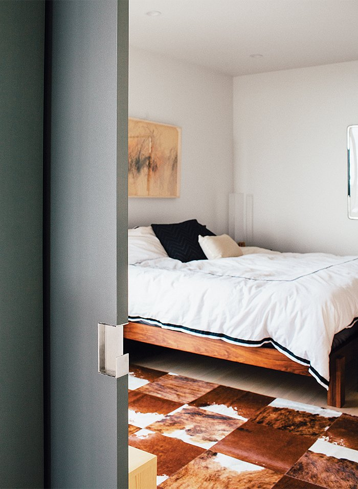 The bed is from Room & Board. Tagged: Bedroom and Bed.  Bedrooms by Dwell from A Home with Eclectic Style Looks Just Right