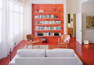 Clean white is supercharged with a background-to-floor-to-fore dose of coral. The adventurous decision to paint the floors makes the room. The background to the home's story is even more beguiling, as one urban resident brings Usonian design to a small city space. It works. Read more.