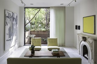 "The West Village renovation was the second project Lubrano completed for her client. ""She is a collector of contemporary art and has minimalist design sensibilities, so she was not necessarily interested in reiterating typical attitudes of how a historic townhouse should present itself,"" Lubrano says. ""This residence creates a mood that is queued not through a rote familiarity, but through a pleasure in precision and a confidence in form making.""<br><br>One of the main challenges was integrating the interiors with the outdoor areas—a luxury in dense Manhattan. On the parlor floor, a floor-to-ceiling window overlooks the patio."