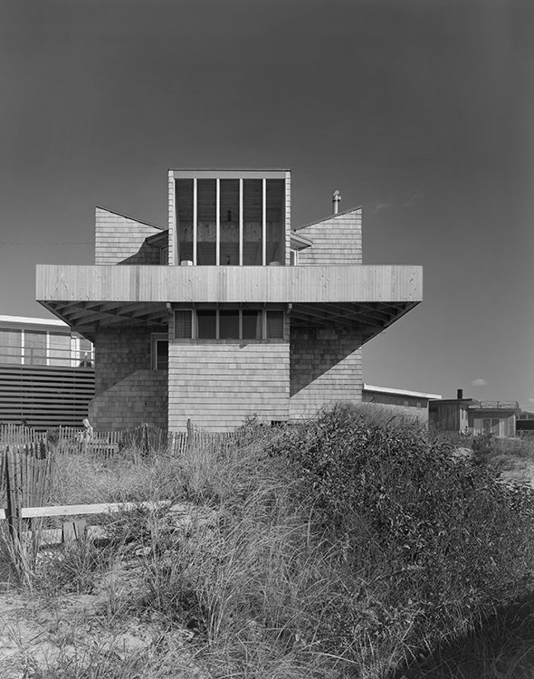 """This 1965 home on Tarpon Walk updates the the shingle-style beach house so common in Long Island vernacular architecture. Delicately balanced on slender tower bases—a """"spaceship"""" as Gifford called it—it hovers over its earthbound neighbors."""