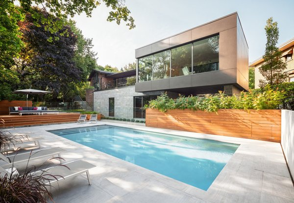 Thellend Fortin Architectes designed this two-story addition in the OUtremont neighborhood of Monteal to capture views from the steeply sloping lot. Photo  of Prince-Philip Residence modern home