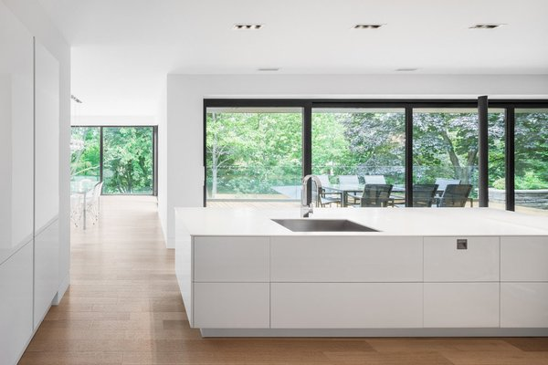 A view of the backyard through the kitchen. Photo 5 of Prince-Philip Residence modern home