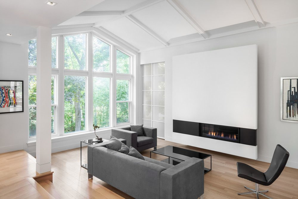 A wall-mounted fireplace is a dominant feature in the living room.