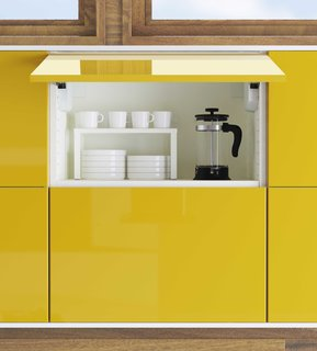 25 Bold Ways to Decorate with Yellow - Photo 13 of 25 - Overhead cabinets now can be easily swung open for ease of access. The kitchens are priced at IKEA's usual retails. A 10 by 10 foot kitchen fitted with Sektion cabinets will range from around $1,300 to $2,200, excluding appliances.