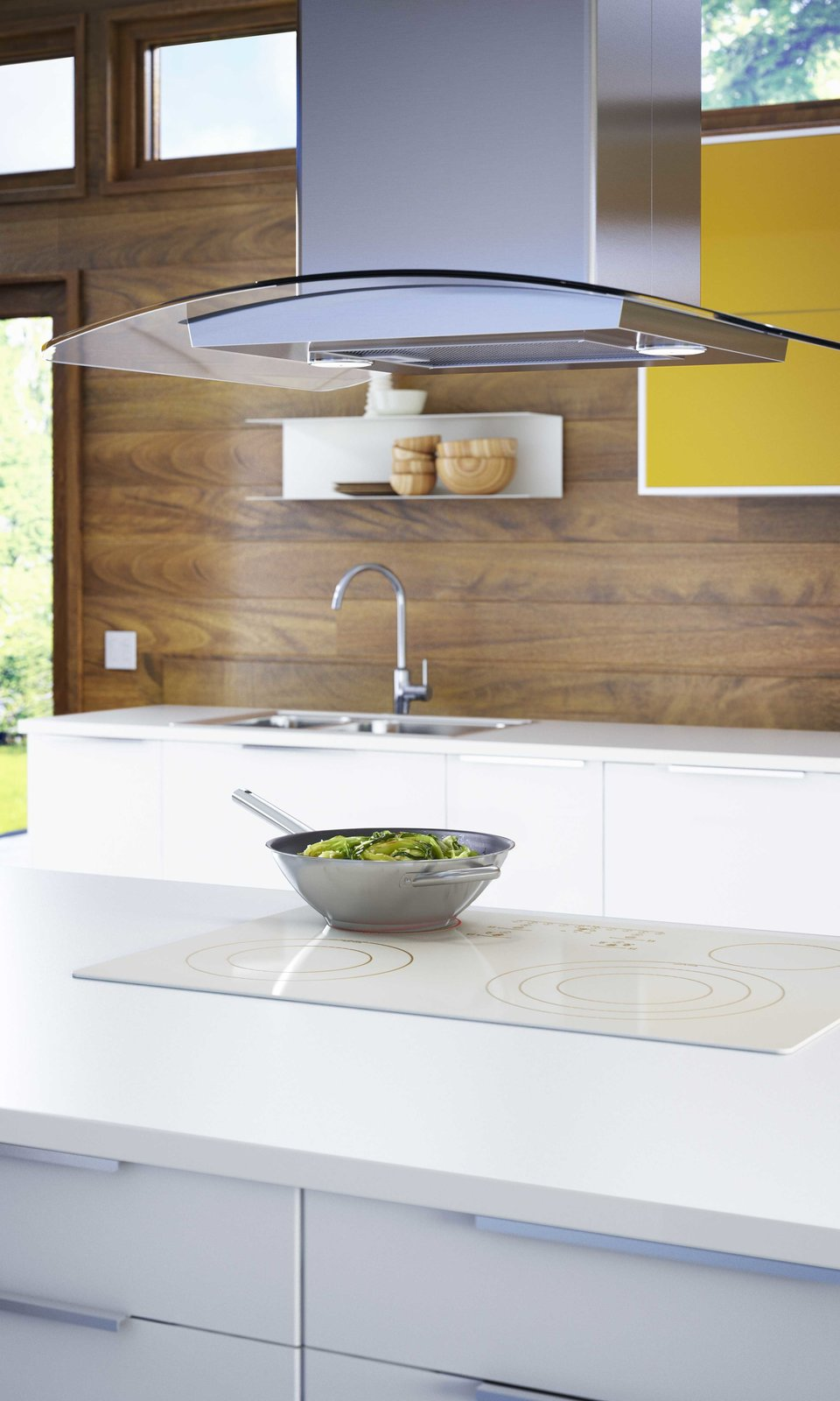 Induction cooktops, growing steadily in popularity due to their energy efficiency and speed, are part of the offering as well as as a selection of exhaust hoods. Tagged: Kitchen, Range, White Cabinet, Range Hood, and Colorful Cabinet.  Photo 4 of 7 in You Can Now Build Your Entire Kitchen with Ikea (Appliances Too!)