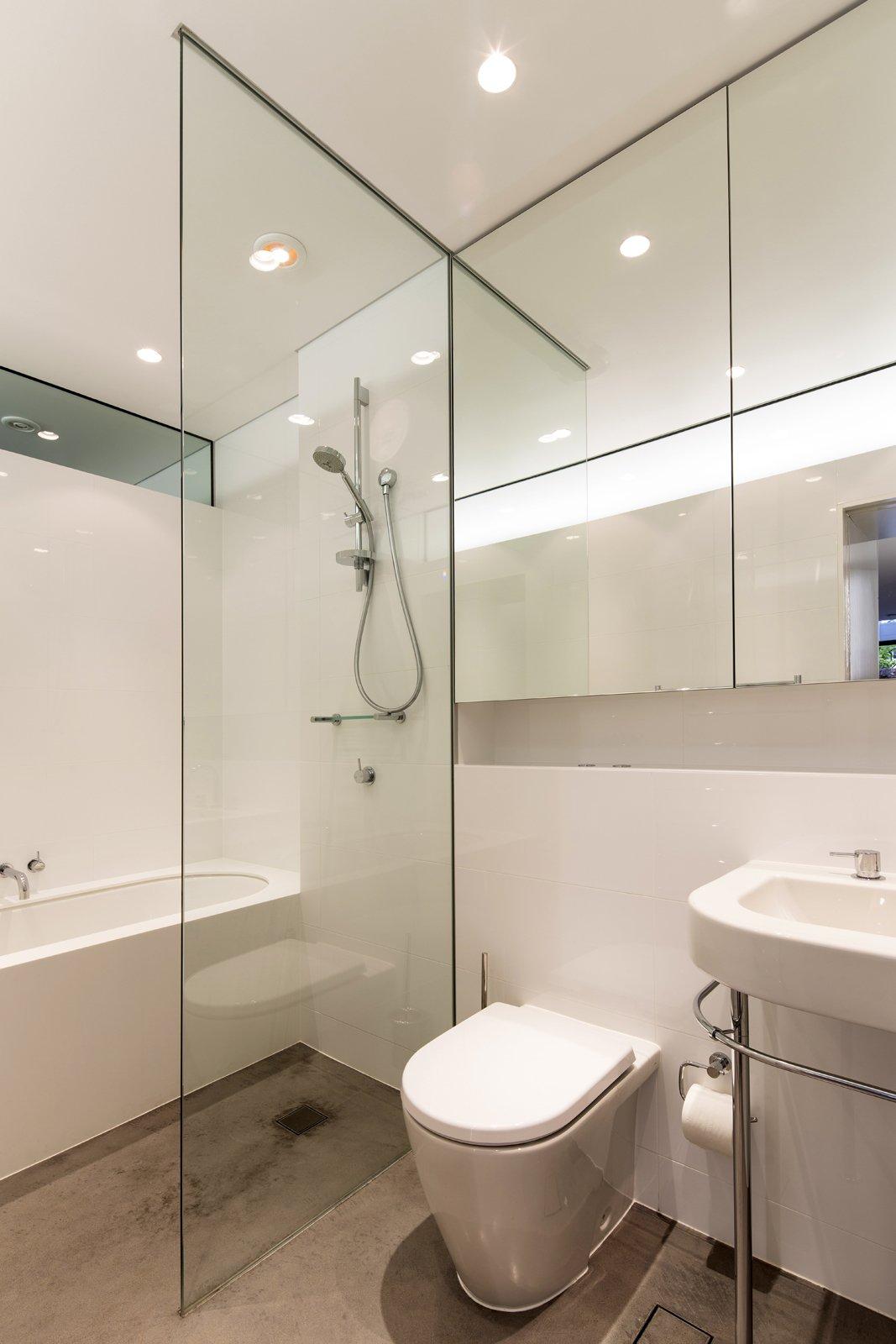 Situated behind the kitchen, the lower level bathroom is equally suited to cleaning up before a meal or taking a leisurely bath. Crisp white fixtures, including a Kaldewei Centro Duo bath, ensure that the bathroom feels as light and airy as the rest of the house.