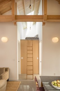 Two bedrooms flank a petite loft space, bringing the apartment's total sleeping spaces to three.