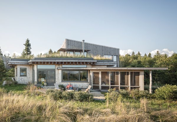 "Architect Will Winkelman and landscape architect Todd Richardson collaborated with a client, JT Bullitt, to design a house that blends into its surroundings in Steuben, Maine. The green roof gives the impression that ""the ground just jumped onto the roof,"" Richardson says."