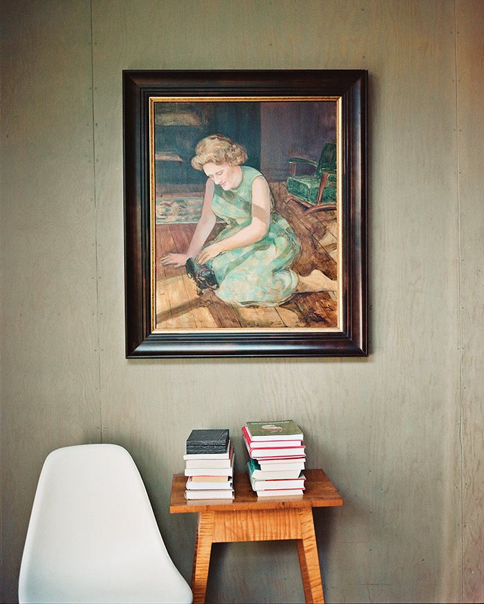 One of the bedrooms became a guest room and study, where a portrait of Green's mother by Evelyn Spence-Reeve hangs above a vintage table. Tagged: Living Room and Chair.  Photo 10 of 15 in L.A. Renovation Respects Midcentury Bones (While Adding Some Flair)