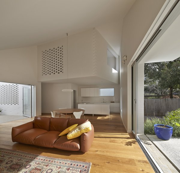 Open brickwork on the cantilevered playroom makes it easier for parents to hear what's happening inside while also adding visual interest to the white walls. Photo 2 of Riverview modern home