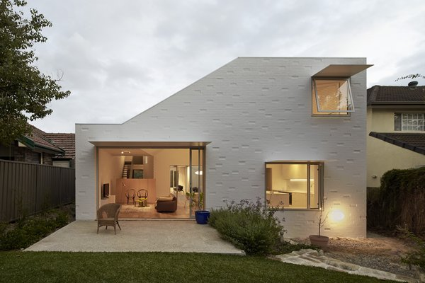 At the back of the house, the windows are sheltered by steel shades. Photo 9 of Riverview modern home