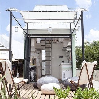 10 Tiny Homes You Can Build - Photo 9 of 10 - A wavy retractable awning structurally defines the outdoor space of this prefab pod concept in South Africa.