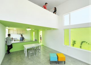 """Vibrant Affordable Housing Prototypes in Los Angeles - Photo 2 of 11 - Working with a construction budget of $165 per square foot, the architecture firm accommodated three bedrooms and two bathrooms in each of the designs and sought to instill the spaces with the elements not typically associated with affordable housing. """"With good, thoughtful design, this category of residences does not have to have an expected, underwhelming look,"""" Michael Lehrer, the firm's president and founder, says. """"Just call it gracious housing with emblems of luxury: ample natural light; views; generous indoor-outdoor relationships; processional spaces; and an open, trusting, and welcoming attitude to the street."""""""