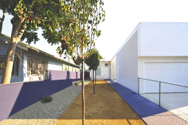 """The houses, like the 53rd Street Prototype, feature lean and gracious walkways to the front door. """"Though these prototypes are set in economically challenged neighborhoods of South Los Angeles, their design provides for integrated defensible space while maintaining openness and connection to the outdoors,"""" states the project description."""