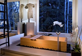 "Japanese Soaking Tubs - Photo 6 of 13 - Tubs can be partly sunk for easier access, as in this tub from Zen BathWorks. The river rocks at the base hide a linear drain, but tubs can also have a regular overflow or drain onto a wet-proofed bathroom floor, says Bill Finlay, of Zen BathWorks. Jennifer Aniston bought a Port Orford Cedar tub from him when she turned the ""his"" part of the bathroom she shared with Brad Pitt into a spa after the couple split up. Bill says many customers site their tub, known as an ofuro in Japanese, to enjoy a view.  Photo courtesy of: Zen BathWorks"