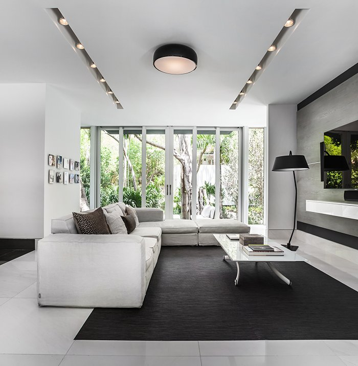 The interiors feature neutral, muted tones in order to highlight the views of the property.  Photo 6 of 12 in This Modern Miami House Feels Like It's in the Middle of the Jungle