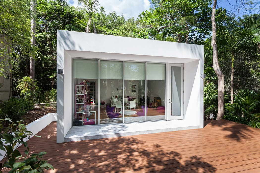 The structure is surrounded by a large deck for play.  Photo 11 of 12 in This Modern Miami House Feels Like It's in the Middle of the Jungle