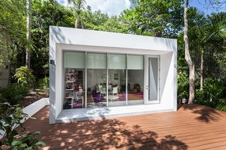 This Modern Miami House Feels Like It's in the Middle of the Jungle - Photo 11 of 12 - The structure is surrounded by a large deck for play.