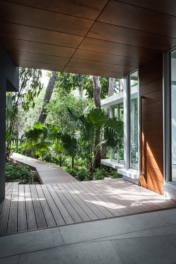"""It didn't seem like the kind of landscape you wanted to go trudging through with your boots, but one that you wanted to observe with detachment,"" architect Allan Shulman says.  Photo 12 of 12 in This Modern Miami House Feels Like It's in the Middle of the Jungle"