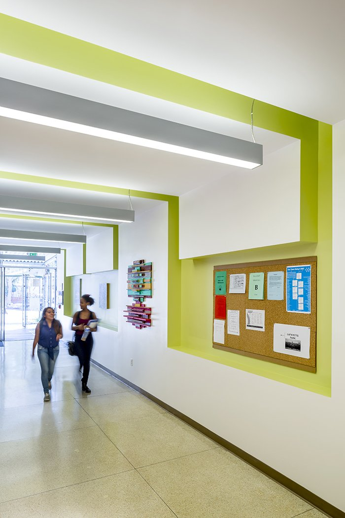 Lime wall insets enliven the school's hallways. A Forgotten Insurance Building Finds New Life as a Humming High School - Photo 4 of 5