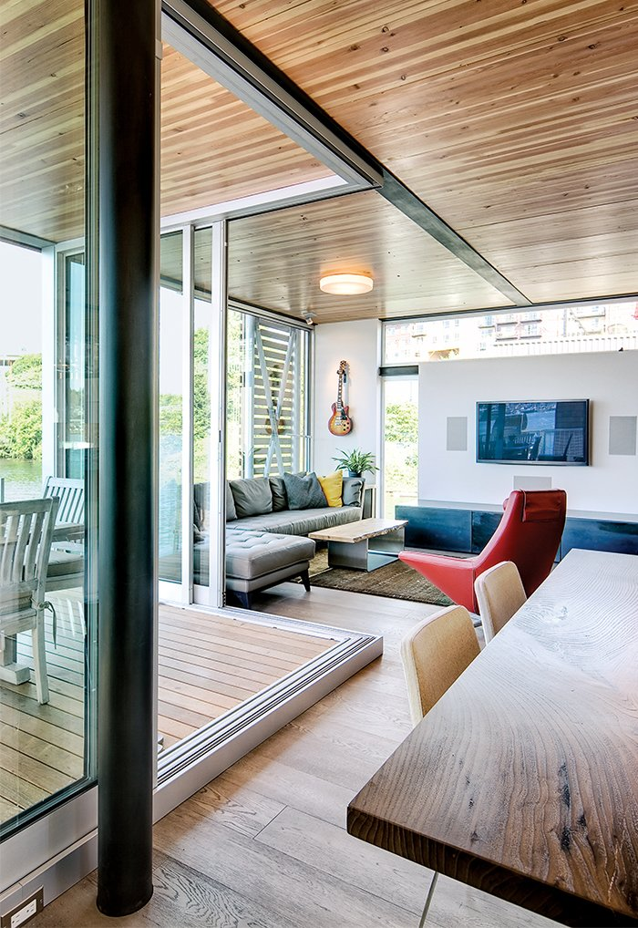 Floor-to-ceiling windows in the main living space overlook Lake Union.  Shining Examples of Clerestory Windows by Luke Hopping from How to Build a Floating Home
