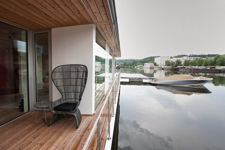 """It's oriented for the river,"" says architect Adam Jirkal. ""It doesn't have an engine. We wanted it to be as low to the water as possible, to really work with the water.""  Photo 4 of 7 in Floating Prefab Concept Rethinks the Houseboat"