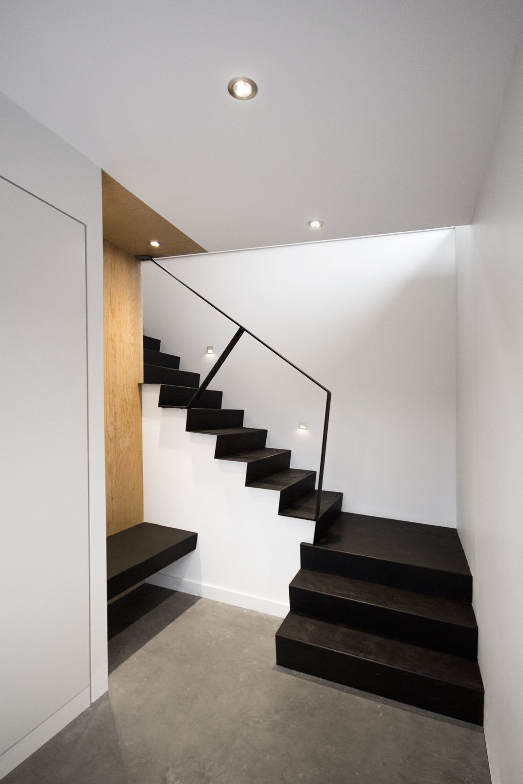The staircase was built using standard wood frame construction with plywood treads. Each step was then covered with a thin sheet of folded steel that outlines its angled profile. Tagged: Staircase and Metal Railing.  Photo 7 of 11 in Amazing Cantilevered Home in the Mountains