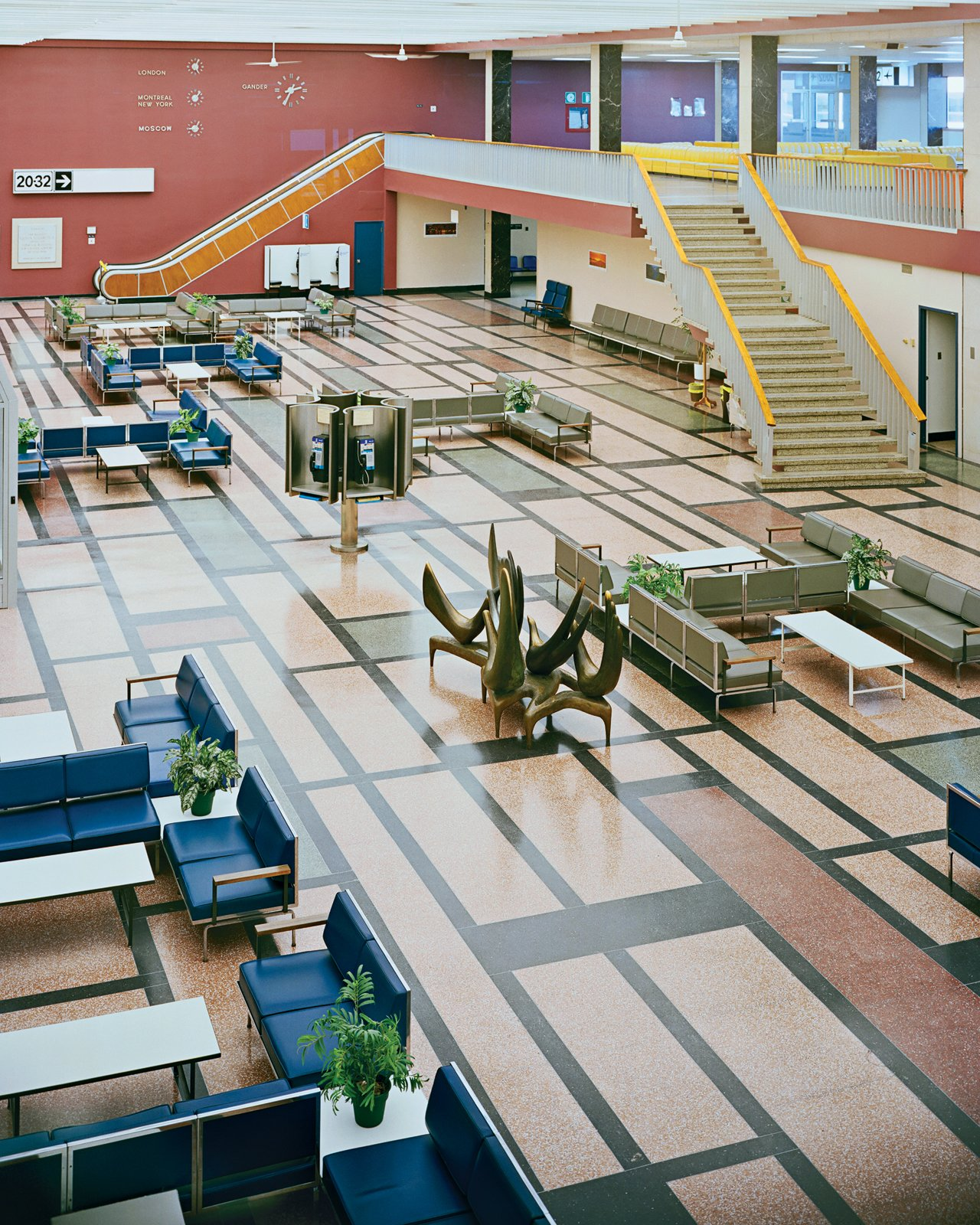 "The international transit lounge at Gander Airport has retained its mid-century Robin Bush seating and Mondrianesque terrazzo floor. Senior curator Rachel Gotlieb from the Gardiner Museum in Toronto says that selecting such modern trimmings for the point-of-entry ""was the beginning of a long march to show that Canada was a progressive nation.""  Photo 8 of 13 in 11 Examples of How to Incorporate Traditional Building Materials Into Your Modern Home from Aviation Preservation"