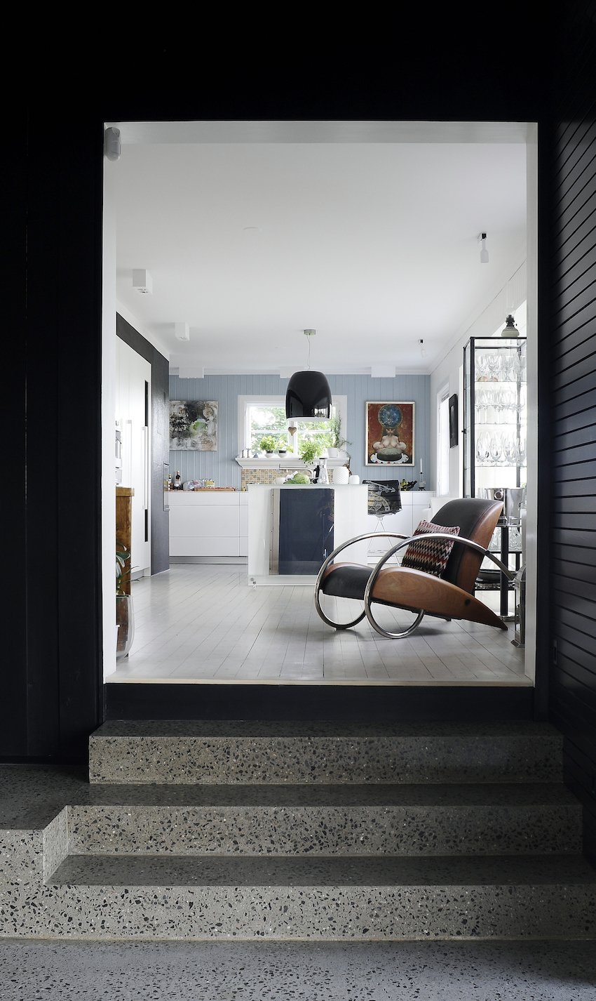 The owners, a couple who work at home, clamored for more space with the new addition. Solbjør created dramatic entrances, such as these stone steps leading into the kitchen, to heighten the contrast between the old and new.