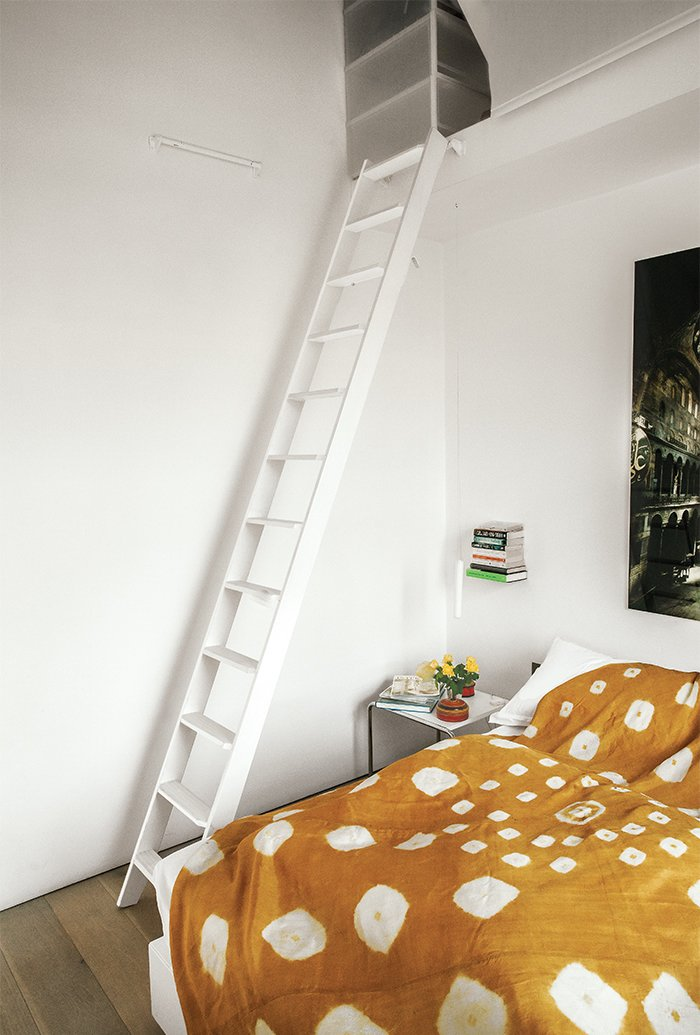 The Laccio side table in the bedroom is by Marcel Breuer for Knoll.  Photo 12 of 14 in An American Ex-Pat Renovates a Tiny London Apartment on Her Own Terms