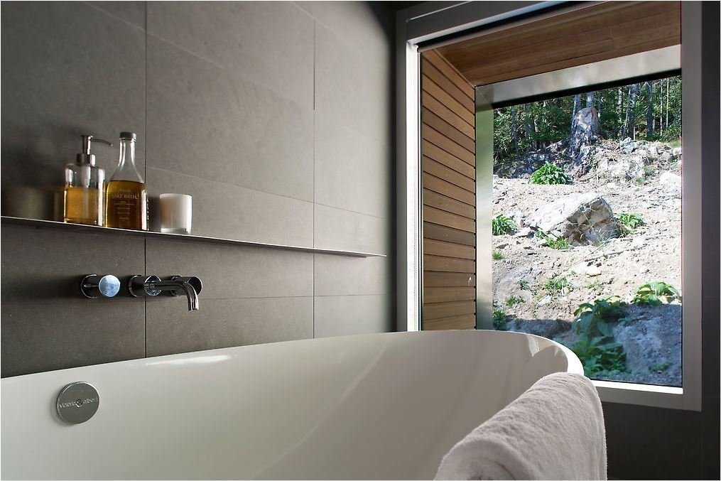 The bathroom was similarly designed to make the most of exterior views. Tagged: Bath Room and Freestanding Tub.  Best Photos from Modern Interiors in British Columbia