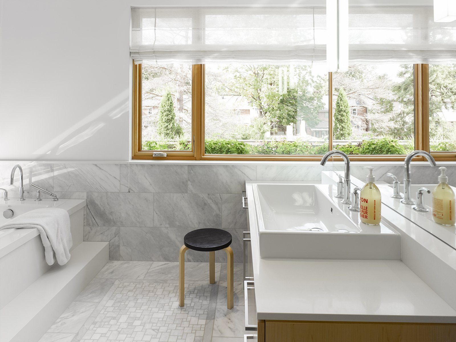 Carrara marble clads the spacious bathroom. Tagged: Bath Room and Vessel Sink.  Photo 7 of 11 in Smart Tech Makes this Modern Home Ultra Energy Efficient