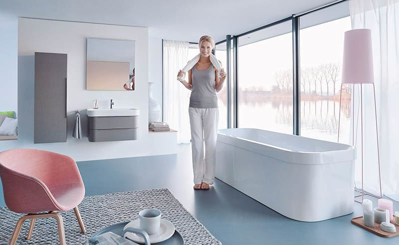For the Happy D.2 line, Sieger Design updated its Happy D. collection from 1998. Like the initial configurations, Happy D.2 has a curvy, D-shaped silhouette. The proportions have been slightly refined and the furniture now comes in a linen-fronted option, shown here on the vanity and wall storage.