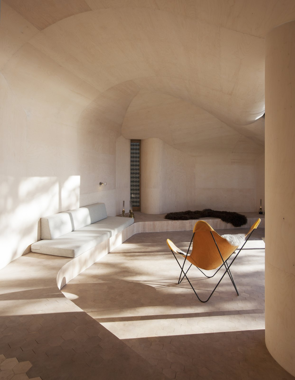 "The cabin's undulating curves are fixed by a prefabricated, laminated wood structure with a subdivision of Kerto CNC-milled plywood. ""It defines the geometry of both the interior and the exterior,"" Bae Brandtzæg says.  Minimalist by Tanya Pavlova from Stand-Alone Statement Chairs"