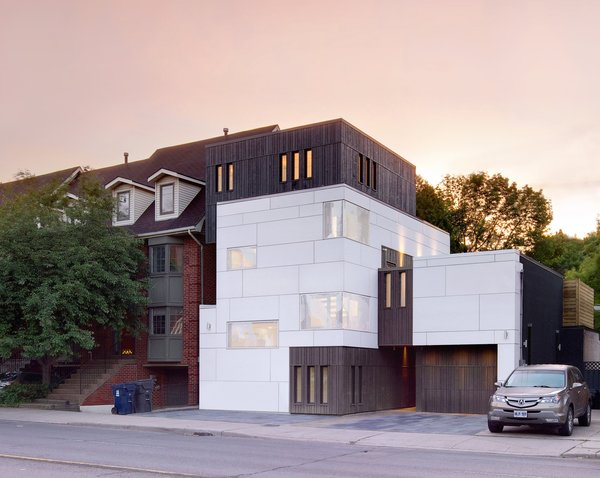 The home's emphasis on light and linearity is evident even from the street, where carefully placed windows and a combination of stained cedar and Eternit cement-fiber panels create a stunning silhouette.