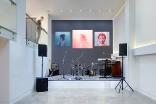The owners host fundraising events throughout the year for a variety of local causes in the home's public spaces. A double-height performance area is perfect for entertainment during these gatherings, during which local talent often performs. The artwork is by Jen Mann.
