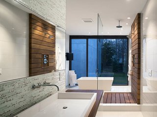 Inspired Indoor Teak Looks - Photo 14 of 14 - In the master bath, a custom raised Silestone sink is surrounded by a teak countertop and Porcelanosa glass tiles. Teak slats anchor the glass-enclosed shower.