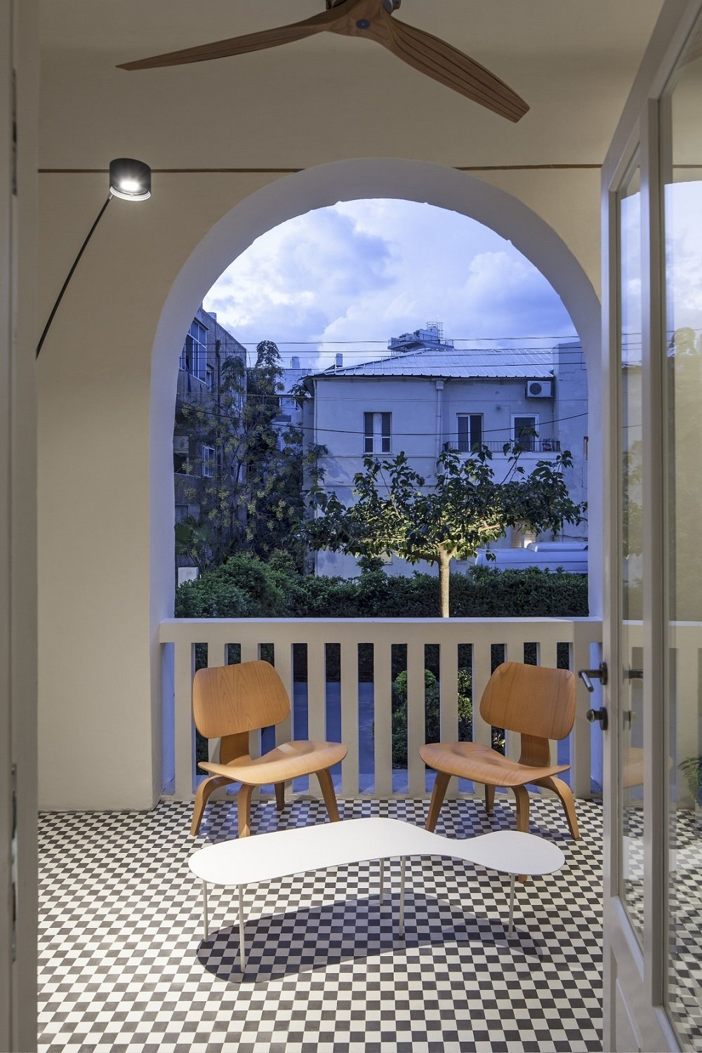 The narrow balcony helps shade the residents while funneling the cool ocean breeze from the west.  Minimal Reboot by Patrick Sisson