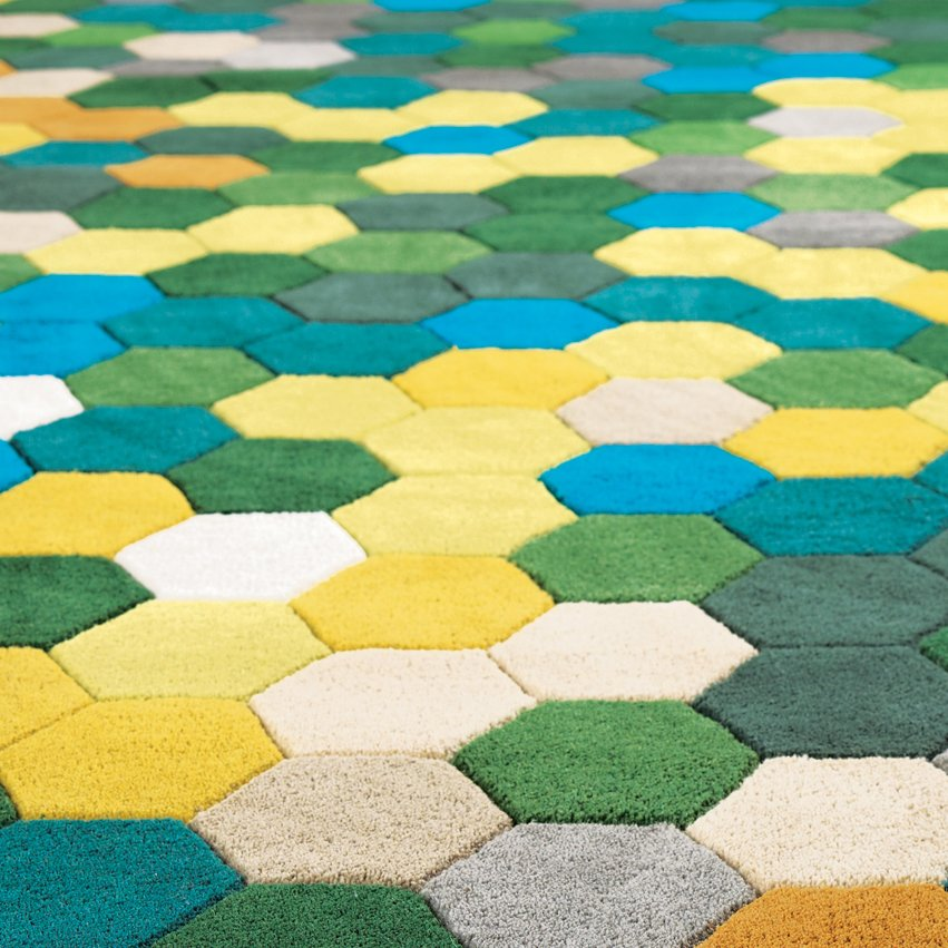 This hand-tufted Kaleidoscope Rug by BoConcept was inspired by pixelated kaleidoscope images. Definitely fit for the modern age.  Rug Collection by Alyx Lance from All Rugged Up