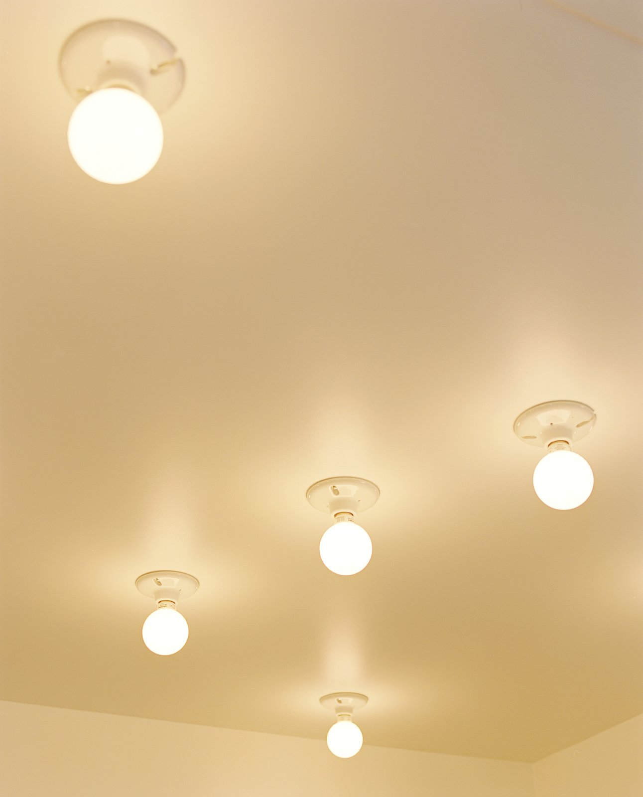 In the kitchen, compact fluorescent lightbulbs affixed to the ceiling are a simple solution.