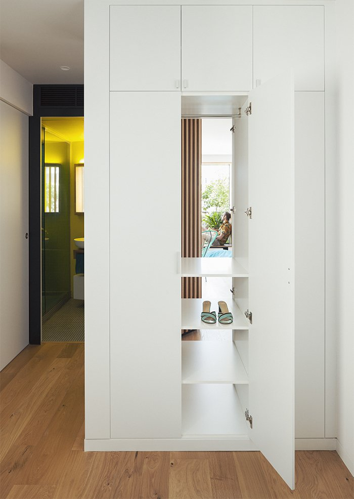 The cupboards in the guest bedroom are accessible from both that room and the hallway.  Photo 9 of 10 in A Childhood Home in Madrid Grows Up