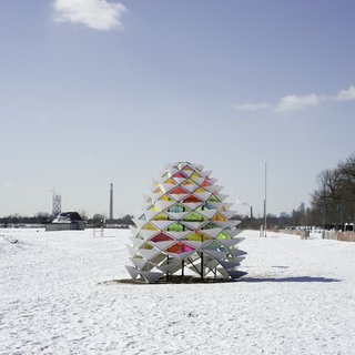 Snowcone: Lily Jeon and Diana Koncan (Ryerson University, Toronto)A welcome burst of color against the white landscape, this geodesic, kaleidoscopic take on the warming hut was inspired by the natural shape of a pinecone and the insulating properties of an igloo.