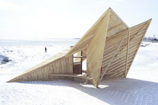 Driftwood Throne: DM_Studio (London)Standing like a sentry on the beach, this angular sculpture assembled from reused timber hides a small bench below a raised viewing platform.