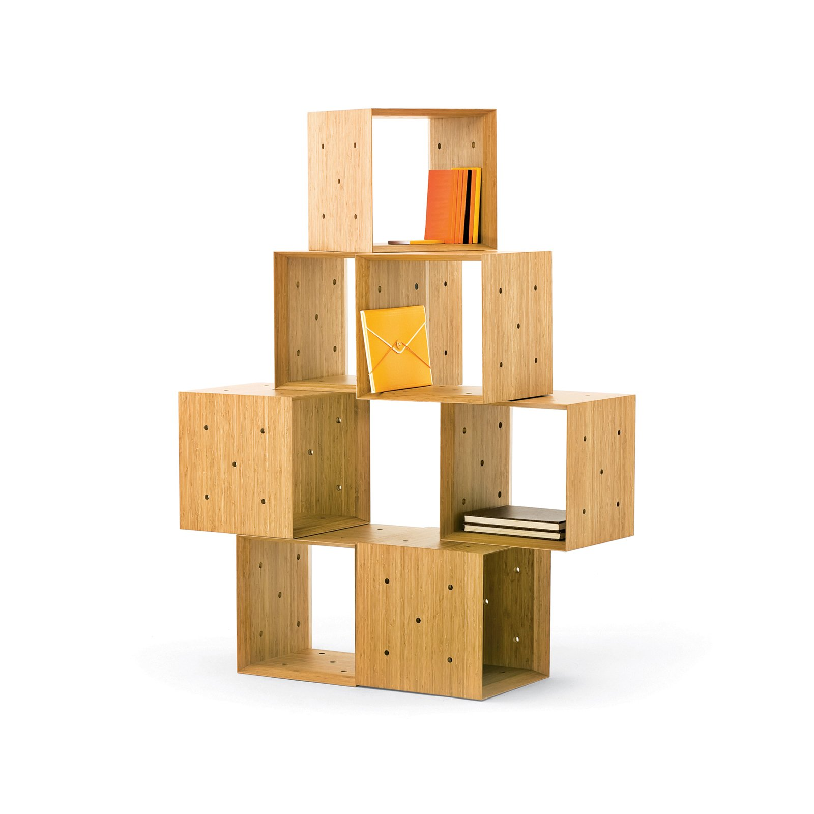 These blocky units lock together with the help of five holes per side––allowing them to take the shape of a miniature library, a bench, or an asymmetrical shelving unit. Read more about this clutter buster here.