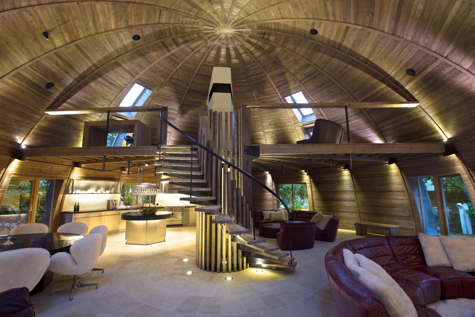 The Dome Home is divided into separate areas where designers can gather or break off to explore ideas. In the loft, a wooden desk blends seamlessly into its wooden environs. Meanwhile, on the lower level Timothy Oulton Shabby sofas with cushions made of real sheepskin off-cuts provide a comfortable place to congregate.