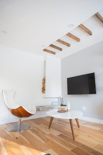 25 Homes With Exposed Wood Beams: Rustic to Modern - Photo 8 of 25 - In lieu of a fireplace, the pair opted for an exposed ethanol burner mounted on exposed concrete (the wood is just decor).