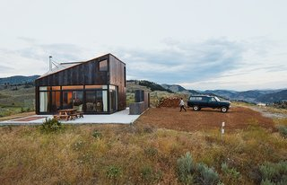 10 Outstanding Prefabs in the Pacific Northwest - Photo 2 of 10 - Architect Jesse Garlick's rural Washington vacation home references its rugged surroundings. The steel cladding has developed a patina similar to the ochre-red color of bedrock found in the area.