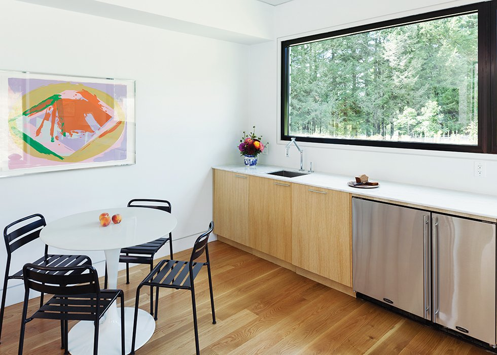 LABhaus designed the custom cabinetry for the mini-kitchen in the great room; the articulated faucet is by Kohler.  Photo 4 of 11 in Cute Couple Alert: Modern Prefab Poolhouse Addition to a 1920s Sears Kit House